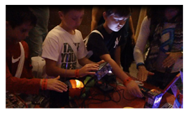 Children playing with Dr. Blankenstein's Circuit Bent Instruments at the World Maker Faire 2012